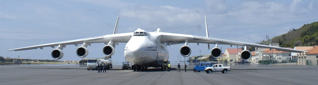 "LAJES FIELD, AZORES -- Portuguese and American workers tend to the Antonov An-225 Mriya, or ""Dream,"" April 28 on the flightline at Lajes Field. The ""Cossack,"" as it is known by NATO, landed here to refuel and get service. Currently the world's largest aircraft, the An-225 was designed mainly to transport the Russian space shuttle ""Buran"" and its components from a service area to a launch site, to Jane's Aircraft Recognition Guide, second edition . It is the only aircraft of its type known to be in existence, according to Jane's. (Photo by Tech. Sgt. Jason Tudor)"